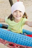 Girl playing on children playground — Stock Photo