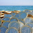 As many euros as sand grains at the beach — Stock Photo