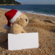 Christmas beach advertisement — Stock Photo