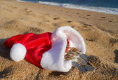 Christmas treasure on the beach — Stock Photo