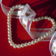 Beads, ribbon and hearts — Stock Photo