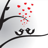 Birds in love on the branch — Stock Vector