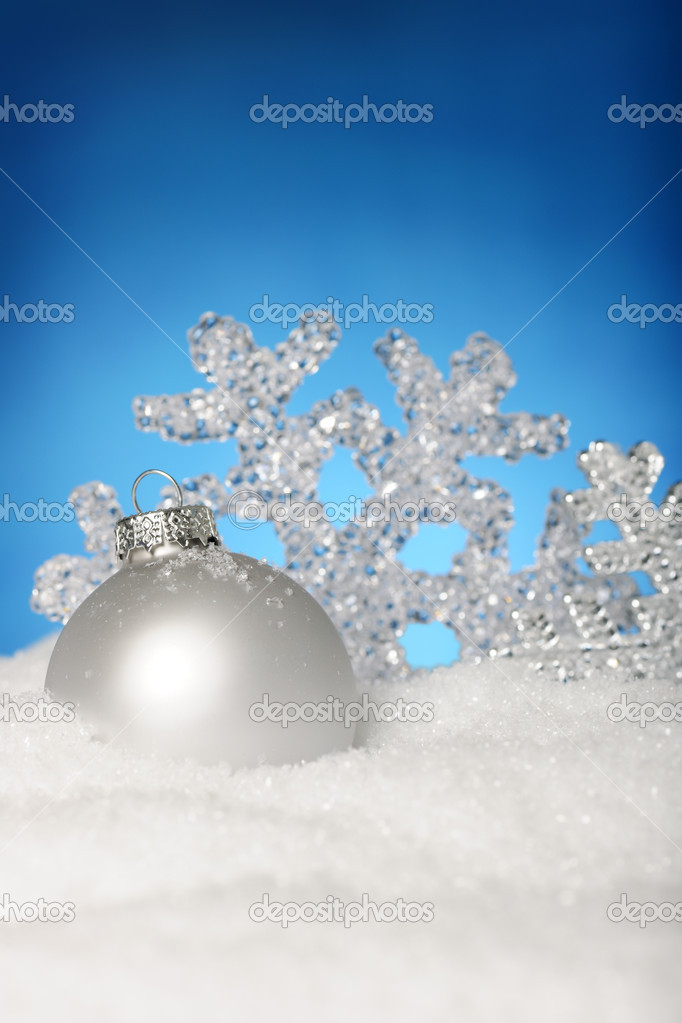 Shiny bauble and snowflake on the snow  Stock Photo #6117784