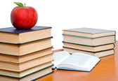 Tower of books and apple — Stock Photo