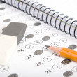 Test score with pencil, notebook and eraser — Stock Photo