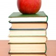 Books tower with apple isolated on white — Stock Photo #6703808