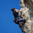 The rock-climber during rock conquest — Stock Photo