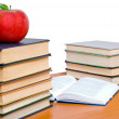 Books tower with apple isolated on white — Stock Photo #6705409