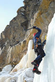 Young man, ice climbing an attractive route. — Stock Photo