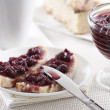 Cherry jam on toast — Stock Photo