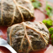 Dolmades with rhubarb leaves, meat and rice - Stock Photo