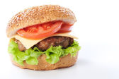 Cheeseburger with tomatoes and lettuce — Stock Photo