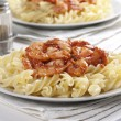 Pasta with tomato and prawns - Stock Photo