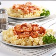 Pasta with tomato and shrimps — Stock Photo