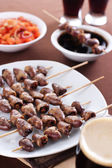 Grilled chicken hearts on skewers — Stock Photo