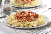 Pasta with tomato and prawns — Stock Photo