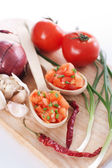 Salsa in two spoons on a wooden board and ingredients — Stock Photo