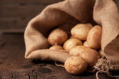 Potatoes in sack — Stock Photo