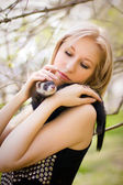 Girl with a polecat — Stock Photo