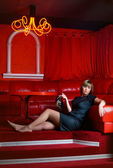 Woman in red interior — Stock Photo