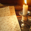 Reading old letter by candle, elegant handwriting — Stockfoto #6088627