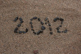 Year 2012 written on sand — Stock Photo
