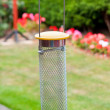 Bird feeder and table — Stock Photo
