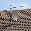 Satellite Dish on Roof - Stock Photo