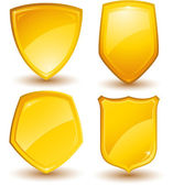 Vector golden shields — Stock Vector