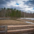 Wooden fence in foreground — Zdjęcie stockowe #6074045