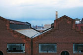View of the roofs on abandoned commercial warehouses. — Stock Photo