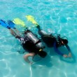 A boy taking scuba diving lessons in the caribbean resort. — Stock Photo #6090384