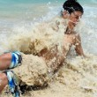 Boy swept by a caribbean surf wave. — Stock Photo #6092290