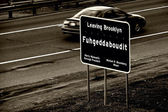 Leaving Brooklyn sign. — Stock Photo