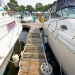 A view of the jetty with private motor yachts. — Stock Photo