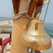 View of the brass bell and mast on the private sail yacht. — Stock Photo