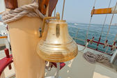 Brass bell on the private sail yacht. — Stock Photo