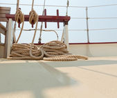 Coiled rope rigging on a sailboat deck. — Stock Photo