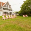 Vacation summer home with pink lawn chairs. — Stock Photo