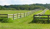 Ancient wooden fence on the farm. — Stock Photo