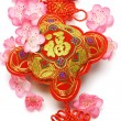 Chinese new year ornament and cherry blossom — Stock Photo