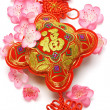 Chinese new year ornament and cherry blossom — Stock Photo #6083248