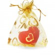 Red love heart ornament in gold sachet — Stock Photo