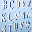 Backlit plastic alphabet stencil — Stock Photo