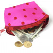 Stock Photo: US notes and coins spilling out from pink purse