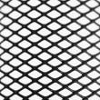 Black wire mesh pattern — Stock Photo