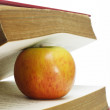 Red apple and old books — Stock Photo