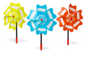 Three colorful toy windmills — Stock Photo