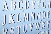 Backlit plastic alphabet stencil — Stock Photo