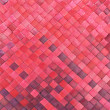 Stock Photo: Red woven palm leaves mat